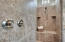 Easy access walk-in master shower with seat and TWO shower heads (one is a rain shower).