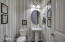 The beautiuful powder room is convenient, yet off hallway away from living room.