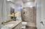 NextGen bathroom has tiled shower, granite countertops, and more.