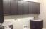 Cabinets galore in the very large laundry room