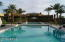 Cascading pools for play, relaxing, or a game of volleyball on a sunny afternoon.