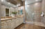 Master bath has double vanities, granite countertops and upgraded tile.