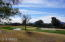 The golf course & mountains are a great backdrop to a very livable home.