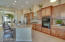 Gorgeous custom cabinets with 12 foot ceilings and lots of recessed lighting
