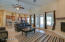 Great room looking into kitchen with french doors to huge covered patio