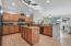 Enjoy cooking in this open kitchen with double door pantry, island, & gas cooktop.