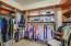Organize your apparel and accessories in this custom walk-in closet.