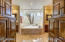 Luxurious Master Bath with his and her vanities