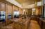 Richly-stained cabinetry that matches the extensive granite counters and island, are ready for your gourmet meals and entertainment. Extensive ceiling lights are low voltage