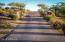 From inside the gate, the beautiful paver driveway provides a stunning entry to the grounds.