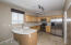 Beautiful kitchen w/custom cabinets/white counters w/molded sink