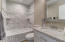 Totally renovated guest bath features new lighting, new quartz counters and highly polished faucets.