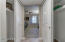 Hall entering the master bedroom is flanked with closets on each side.