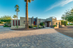 Stunning curb appeal with custom pavers and ample parking