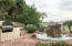 built in BBQ and rock waterfall fountain