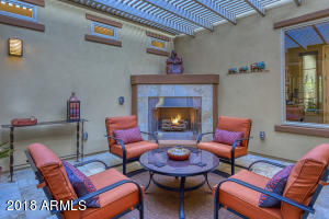 Extension of indoor space, opens to kitchen or great room. Pergola cover and gas fireplace. Cozy and Comfortable.