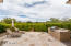 Enjoy this lush private north facing patio with a built-in BBQ with open skies and McDowell Mountain views to the east.