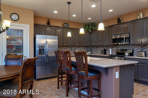 Eat-In Kitchen with Silestone countertops, stainless appliances and breakfast bar