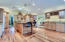 Gorgeous chef kitchen, vaulted ceilings, wet bar, double ovens and huge island with breakfast bar!