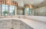 Second bedroom en suite has walk in shower and large vanity!