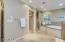 Elegant master bathroom boasts his/her sinks, vanity, soaking tub and walk in shower!