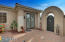 front gate to courtyard and front door to separate guest casita