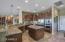 kitchen w/granite countertops and backsplash and SS appliances