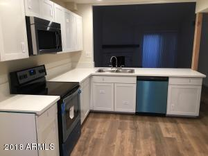 New white, shaker-style cabinets, quartz counter tops, and new stainless appliances.