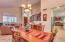 Formal dining with pass through into kitchen.
