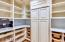 storage panty with Miele coffee station and additional refrigerator. Carerra Marble subway tile backsplash