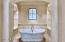 solid carrera marble with Rohle exposed faucet