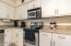Beautiful white cabinetry with trendy hardware