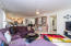 Spacious family room looks into the kitchen great for entertaining