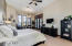 spacious Master bedroom, beautiful shutters and shades to filter the lights.