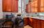 Laundry room with Quartz slab countertop.