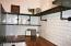 Custom open shelving in kitchen