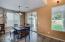 Wood-Encased Glass Slider & Lots Of Windows In This Large Breakfast Room