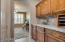 Butlers Pantry & Large Walk-In Pantry Lead To Formal Dining