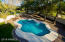 Private 9ft heated diving pool, on the southeast corner of the .35 acre corner lot