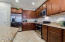 Maple Cabinetry, Stainless Steel Appliances, and Pantry