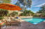 Travertine decking offers space to soak in the sun