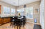 Eat-in kitchen breakfast nook has extra cupboards for additional storage