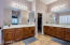 You both have your own space in this large master bath