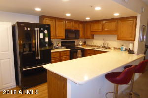 Lovely kitchen remodel! Opened up the kitchen area and added quartz countertops