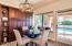 A casual dining area offers a glimpse of the private oasis