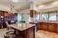 Gourmet kitchen includes island with bar seating