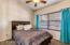 Guest Suite with Ceiling Fan & Plush Carpet