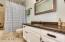 Guest / Hall Bathroom. Updated Stylish Tile Floor, Granite Countertop & Tile Shower & White Cabinets