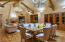 Reclaimed wood beamed ceiling and antique chandeliers. French doors leading to a entertaining patio