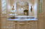 Carrera marble counter top with antique vessel sink.